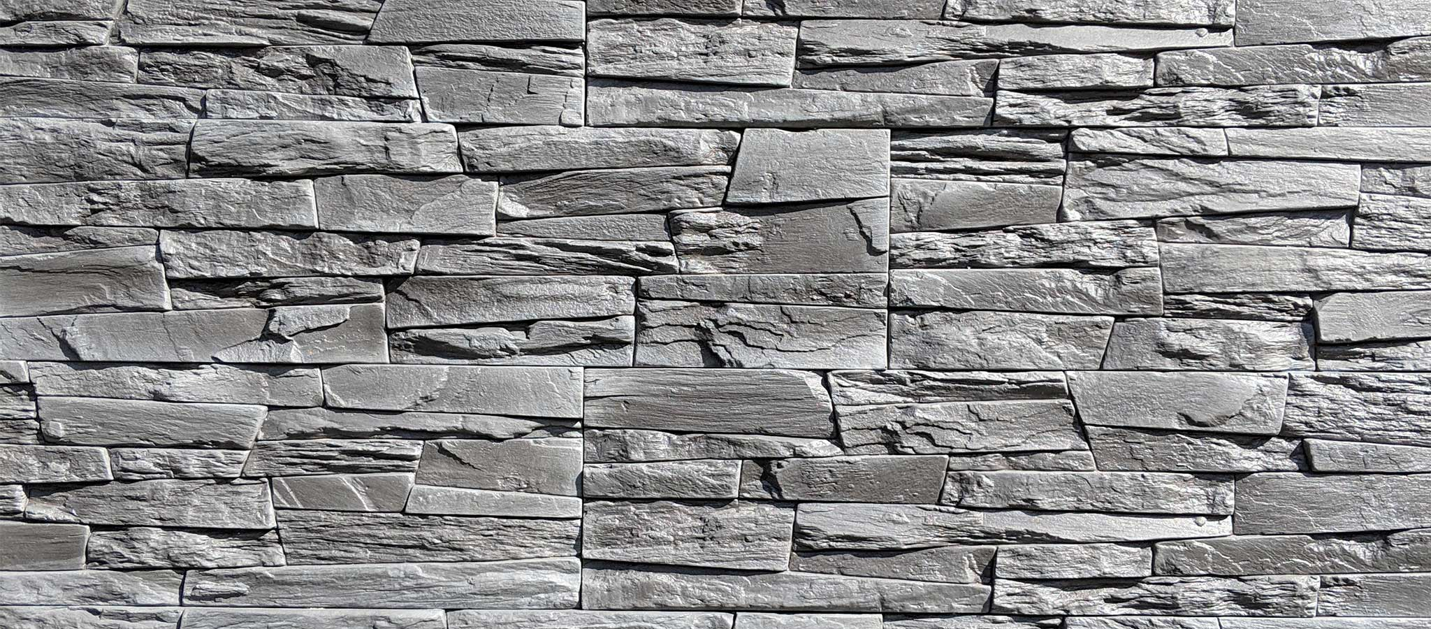 Dedicated Roofing & Exteriors - Stone Siding Professional Roofing Calgary Roof Repair Roof Replacement Roof Inspection